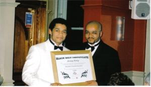 Shihan Jeremy receiving his 4th Dan 2003
